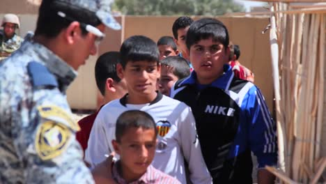 Us-Soldiers-Hand-Out-Water-Filters-Toys-And-School-Supplies-To-People-In-Baghdad-Iraq-4