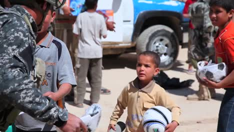 Us-Soldiers-Hand-Out-Water-Filters-Toys-And-School-Supplies-To-People-In-Baghdad-Iraq-5