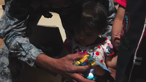 Us-Soldiers-Hand-Out-Water-Filters-Toys-And-School-Supplies-To-People-In-Baghdad-Iraq-7
