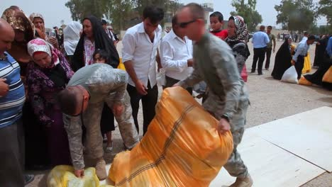 Us-Soldiers-Hand-Out-Food-Toys-And-School-Supplies-To-People-In-Baghdad-Iraq-1