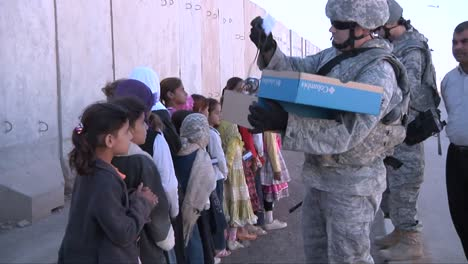 Kids-Take-Handouts-From-Us-Soldiers-In-Iraq