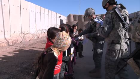 Kids-Take-Handouts-From-Us-Soldiers-In-Iraq-1