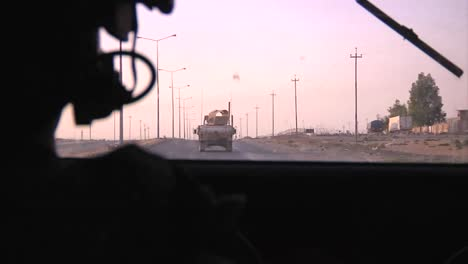 Pov-Shot-From-An-Armored-Humvee-Of-Us-Soldiers-In-A-Convoy-On-A-Highway-In-Iraq