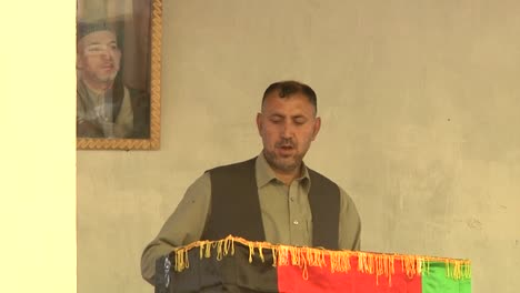 Afghan-Villagers-Listen-To-A-Local-Official-Give-A-Speech