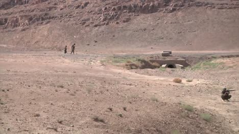 A-Us-Convoy-Conducts-Ied-Patrols-Using-Metal-Detectors-Along-A-Road-In-Afghanistan