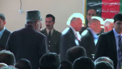 Afghan-Government-And-Military-Officials-Gather-In-A-Large-Hall-For-A-Speech