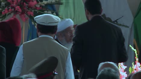 Afghan-Government-And-Military-Officials-Pray-In-A-Large-Hall-For-A-Speech