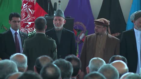 President-Hamid-Karzai-Of-Afghanistan-Greets-Graduates-Of-A-Military-School