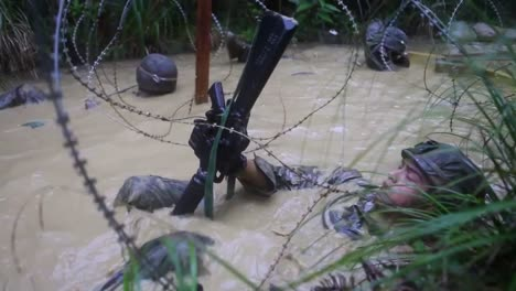 Marines-In-Basic-Training-Go-Through-Various-Workout-Drills-Including-Being-In-A-Swamp-With-Barbed-Wire