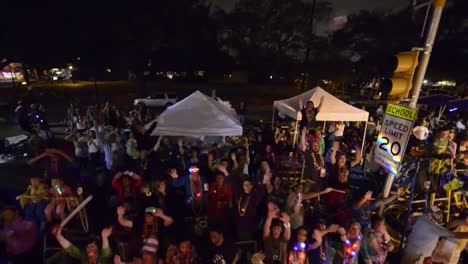 Pov-From-A-Mardi-Gras-Float-Passing-At-Night-Of-People-Cheering-And-Partying