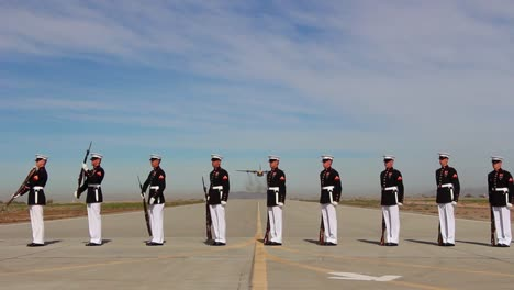 Us-Marine-Honor-Guard-Performs-As-Plane-Does-A-Flyover