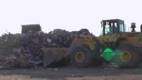 Huge-Piles-Of-Garbage-And-Rubble-Are-Bulldozed-In-A-Junkyard-Following-Hurricane-Sandy-1