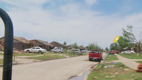 Residents-Pick-Through-The-Ruins-Of-Their-Homes-After-The-Devastating-2013-Tornado-In-Moore-Oklahoma-3