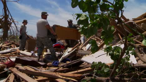 Residents-Pick-Through-The-Ruins-Of-Their-Homes-After-The-Devastating-2013-Tornado-In-Moore-Oklahoma-4