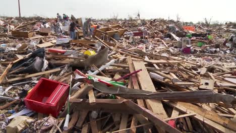 Residents-Pick-Through-The-Ruins-Of-Their-Homes-After-The-Devastating-2013-Tornado-In-Moore-Oklahoma-8