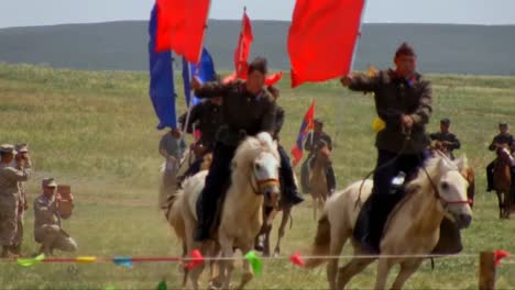 Mongolian-Horsemen-Ride-In-A-Ceremonial-Event