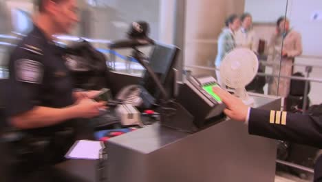 Passengers-Coming-Into-An-International-Airport-Terminal-Pass-Through-Us-Customs-And-Are-Photographed-And-Fingerprinted