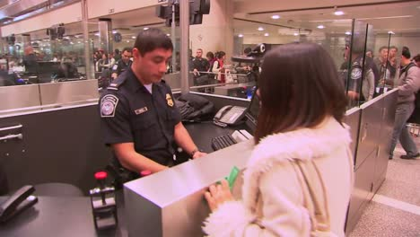 Passengers-Coming-Into-An-International-Airport-Terminal-Pass-Through-Us-Customs-And-Are-Photographed-And-Fingerprinted-3