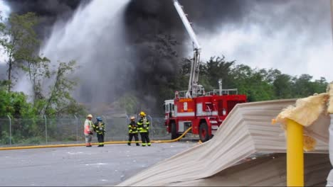 Raw-News-Footage-As-Firefighters-Battle-A-Fire-And-Explosion-After-A-Train-Derailment