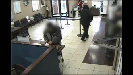 Surveillance-Camera-Footage-Of-An-Armed-Robber-Robbing-A-Bank