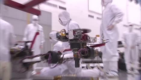 Nasa-Scientists-Work-In-The-Lab-To-Mount-The-Robotic-Arm-Of-The-Mars-Rover