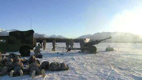 A-Piece-Of-Artillery-Is-Fired-In-A-Snowy-Landscape