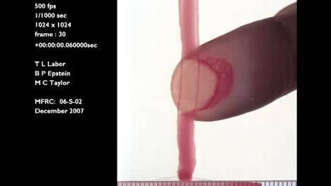 A-Forensics-Crime-Lab-Studies-A-Slow-Motion-Blood-Smear-Caused-By-The-Swipe-Of-A-Finger