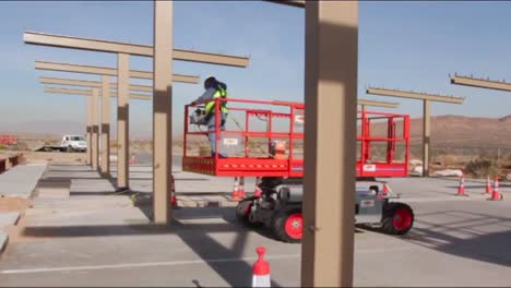 Construction-Workers-Build-A-New-Solar-Parking-Structure-In-The-Desert