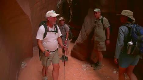 Tourists-Admire-Paria-Canyon-Arizona-And-Rock-Carvings-And-Slot-Canyons-2