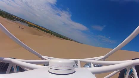 Exciting-Pov-Shot-Of-A-Dune-Buggy-Across-Sand-Dunes-1