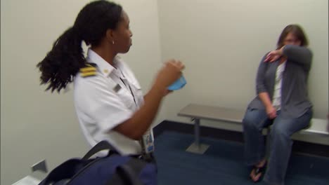 A-Traveler-Is-Inspected-For-Disease-By-A-Cdc-Official-During-Quarantine-At-An-Airport