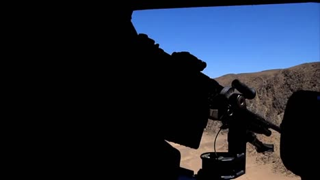 A-Door-Gunner-On-A-Helicopter-Fires-Machine-Guns-During-A-Flight-Over-Afghanistan