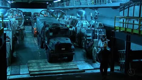 Expeditionary-Units-Are-Loaded-Into-The-Hull-Of-A-Navy-Ship-In-Preparation-For-War