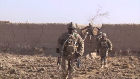 Marines-Go-On-Patrol-In-Kandahar-Province-Afghanistan-And-Uncover-And-Explode-An-Ied-Device-Along-The-Road-1