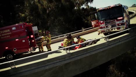 A-Motorcycle-Rider-Has-A-Bad-Accident-On-The-Freeway-And-Is-Attended-By-The-Fire-Department