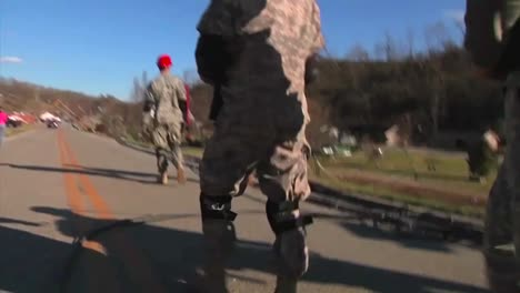 National-Guard-Soldiers-Patrol-A-Neighborhood-In-West-Liberty-Kentucky-Following-A-Devastating-Tornado-2