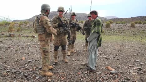 Us-Soldiers-Man-An-Afghan-Checkpoint-Where-Civilians-Are-Stopped-And-Searched