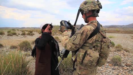Us-Soldiers-Man-An-Afghan-Checkpoint-Where-Civilians-Are-Stopped-And-Searched-As-A-Storm-Moves-In