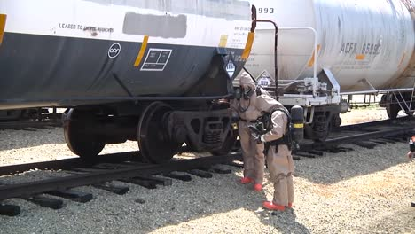 Hazmat-Clad-Experts-Prepare-For-A-Terrorist-Attack-Or-Chemical-Spill-From-The-Derailment-Of-A-Tanker-Train