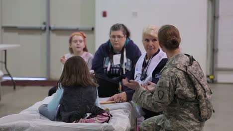 People-Take-Refuge-At-A-Red-Cross-Emergency-Shelter-During-A-Disaster