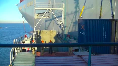 Time-Lapse-Of-A-Cargo-Ship-At-Sea-And-Docking-And-Unloading