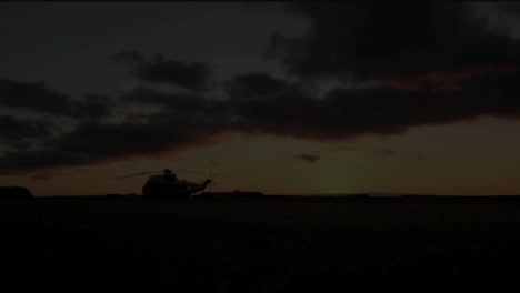 Sunrise-At-A-Military-Base-With-Helicopters-On-The-Runway