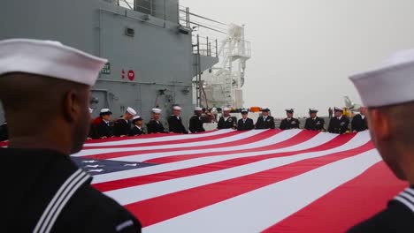 Navy-Personnel-Hold-A-Giant-American-Flag-In-A-Display-Of-Patriotism