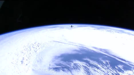 A-Satellite-Floats-High-Above-The-Earths-Surface