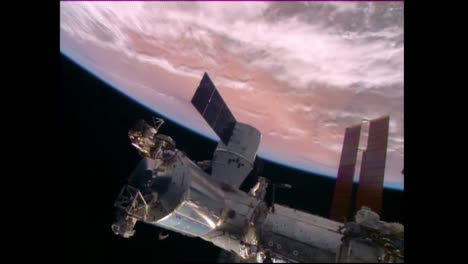A-Satellite-Floats-High-Above-The-Earths-Surface-4