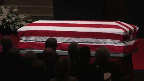 A-Patriotic-Flag-Draped-Coffin-Sits-At-An-Official-State-Military-Funeral