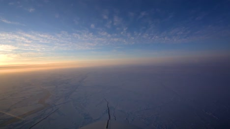 Pov-Shot-From-The-Front-Of-A-Plane-Flying-Over-Frozen-Arctic-Tundra-1