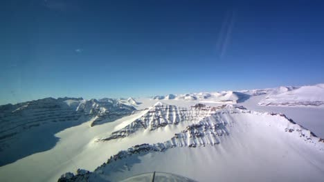 Pov-Shot-From-The-Front-Of-A-Plane-Flying-Over-Frozen-Arctic-Tundra-Of-Greenland-1