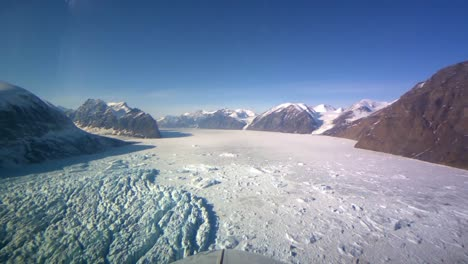 Pov-Shot-From-The-Front-Of-A-Plane-Flying-Over-Frozen-Arctic-Tundra-Of-Greenland-2