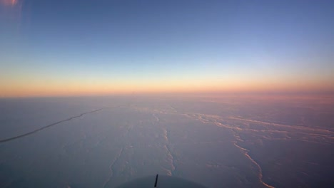 Pov-Shot-From-The-Front-Of-A-Plane-Flying-Over-Frozen-Arctic-Tundra-3